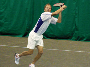 Man Playing on Indoor Courts