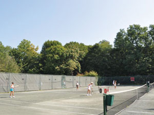 Women Playing on Outdoor Courts