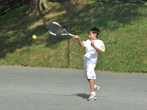 Boy Playing on Outdoor Courts