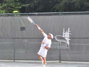 Man Serving on Outdoor Courts