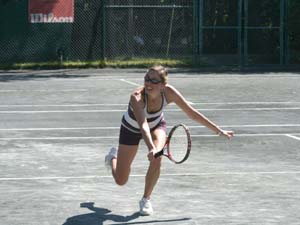 Woman Playing on Outdoor Courts
