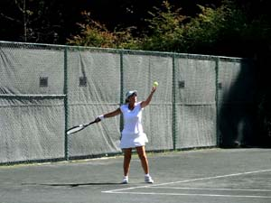 Woman Serving on Outdoor Courts